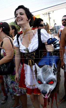 "A girl, dressed as Little Red Cap, participates at carnival festivities of  ""bloco"" (carnival group) Toco-xona, Rio de Janeiro, Brazil, February 18, 2012. (Austral Foto/Renzo Gostoli)"