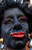 A reveler participates at carnival festivities during a carnival parade of the traditional Banda de Ipanema in an Ipanema street, Rio de Janeiro, Brazil, February 7, 2009. Hundreds gathered for the annual 'Band of Ipanema' samba parades through the beachfront, the city's most famous street party of the year. (Austral Foto/Renzo Gostoli)