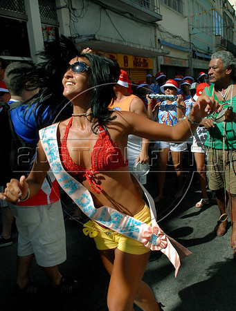 """Revelers partcipate at a """"Bloco"""" neighborhood carnival street parade in Rio de Janeiro, Brazil, February 6, 2010. The Blocos are regaining popularity as the official carnival parades, where samba schools compete for the best parade, increases in price.<br />  (Austral Foto/Renzo Gostoli)"""