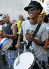 A drummer with a gun replica, participates at carnaval festivities, Rio de Janeiro, Brazil, february 26, 2011. (Renzo Gostoli/Austral Foto)
