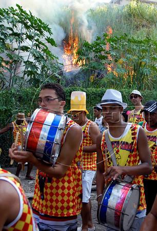 Drummers past by fire during carnival festivities, Rio de Janeiro, Brazil, february 26, 2011. (Renzo Gostoli/Austral Foto)