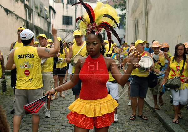 A reveler participates in an afternoon street parade during a pre-carnival event in downtown neighborhood, Rio de Janeiro, Brazil, February 14, 2009. (Austral Foto/Renzo Gostoli)