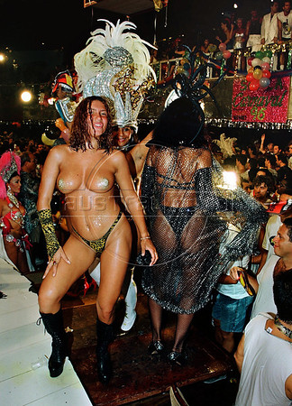 Two girls dance on a table at one of the carnival balls during Carnival festivities, Rio de Janeiro, Brazil, February 18, 1996.<br /> (Austral Foto/Renzo Gostoli)