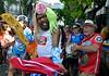 Revelers participate at carnaval festivities, Rio de Janeiro, Brazil, february 26, 2011. (Renzo Gostoli/Austral Foto)