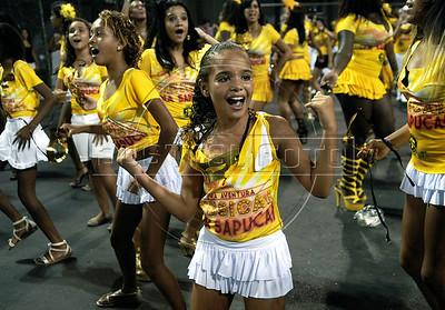 Childs perform during a Sao Clemente samba school's rehearsal at the Sambadrome, Rio de Janeiro, February 4, 2012. All week end of January and February the Rio's samba schools train in the Sambadrome for the carnival parade. The 2012 carnival start officially February 18. (Austral Foto/Renzo Gostoli)