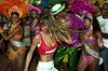 Brazilian top model Gisele Bundchen, right, dances with Mangueira's dancers during a visit to samba school Mangueira, Rio de Janeiro, Brazil, February 20, 2004. The carnival started officially today. (Austral Foto/Renzo Gostoli)