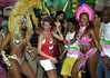 Brazilian top model Gisele Bundchen, center, dances with Mangueira's dancers during a visit to samba school Mangueira, Rio de Janeiro, Brazil, February 20, 2004. The carnival started officially today. (Austral Foto/Renzo Gostoli)