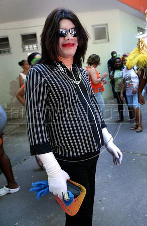 "A patient from mental health hospital Nise da Silveira, dressed as Michael Jackson, participates at carnival festivities of ""Loucura Suburbana"" carnival group, Rio de Janeiro, Brazil, February 16, 2012. (Austral Foto/Renzo Gostoli)"