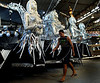 A worker pasts by a float for a samba school, Rio de Janeiro, Brazil, February 3, 2010. The float will be used during the carnival parades which begin on February 12, 2010. Thousands of people work for 6 months out of the year preparing for carnival. (Austral Foto/Renzo Gostoli)