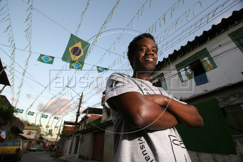 """Leandro Firmino, known for his role as """"Ze Pequeno"""" (Little Joe) in the film Cidade de Deus (CIty of God), poses in the slum of the same name, where he lives. (Australfoto/Douglas Engle)"""