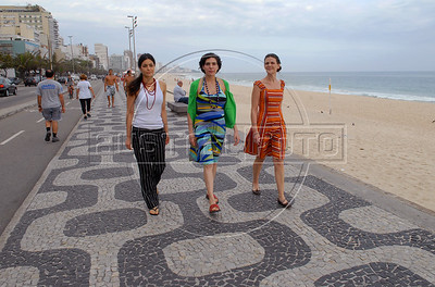 "Argentinian actresses Nora Anghileri, left, Analia  Couceyro, center, and Ana Celentano, right, walk along Leblon beach before the  photocall to present their film"" O Passado"" (The Past), which chronicles a married couple's difficult breakup in Rio de Janeiro, Brazil, Oct. 22, 2007.  (Austral Foto/Renzo Gostoli)"