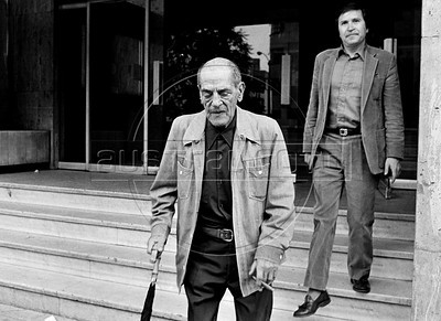 """Spanish filmmaker Luis Bunuel (1900-1983),and mexican writer Homero Aridjis go out af the theatre after assists at the theatre piece """"Moctezuma"""", Mexico DF, Mexico, april 1982. Luis Bunuel, considered one of the most influential directors in the history of cinema, make, between others, the films """"Un Chien andalou"""", 1929, """"Los olvidados"""", 1950, """"The Exterminating Angel"""", 1962, """"Viridiana"""", """"Belle de Jour"""", 1967, """"Cet obscur objet du désir"""", 1977. (Austral Foto/Renzo Gostoli)"""