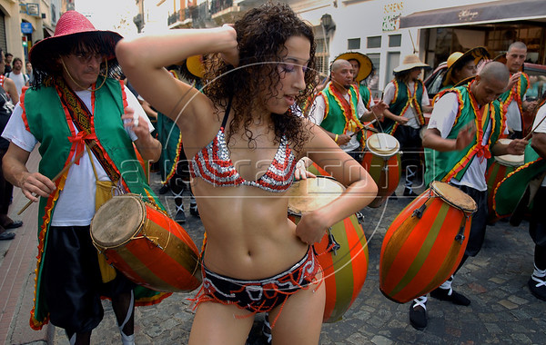 A girl dances at traditional San Telmo district during festivities of candombe, a musical genre originated from the influences of African music and developed on both banks of the Rio de la Plata because of the large influx of slaves during the colonial period, Buenos Aires, Argentina, december 12, 2006. (Austral Foto/Renzo Gostoli)
