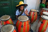 A man prepares drums at traditional San Telmo district before participate at festivities of candombe, a musical genre originated from the influences of African music and developed on both banks of the Rio de la Plata because of the large influx of slaves during the colonial period, Buenos Aires, Argentina, december 12, 2006. (Austral Foto/Renzo Gostoli)