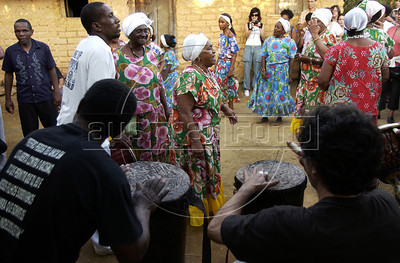 "Women dance at fazenda Sao Jose, Quissama, during a Jongo celebration, Rio de Janeiro, Brazil, May 14, 2005. The Jongo- part dance and part spirit religion ritual- is a legacy of the African slaves who worked in the coffee fields in the state of Rio de Janeiro. UNESCO calls jongo part of Brazil's ""intangible culture. (Austral Foto/Renzo Gostoli)"
