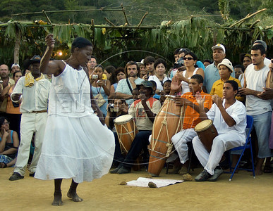 "A woman dances at fazenda Sao Jose, Quissama, during a Jongo celebration, Rio de Janeiro, Brazil, May 14, 2005. The Jongo- part dance and part spirit religion ritual- is a legacy of the African slaves who worked in the coffee fields in the state of Rio de Janeiro. UNESCO calls jongo part of Brazil's ""intangible culture. (Austral Foto/Renzo Gostoli)"