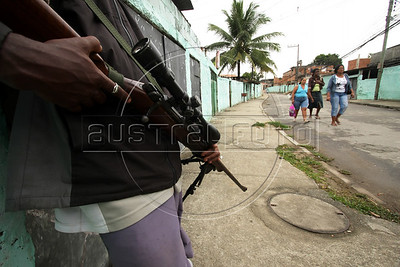 "Dancing with the Devil production stills. Drug traffic ""soldier"" in Vila Aliana, Pastor Dione's district. (Australfoto/Douglas Engle)"