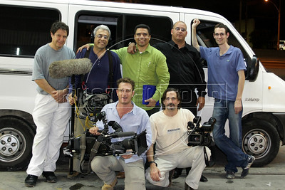 Dancing with the Devil production stills. The crew with Pastor Dione, next to the van.(JBFC/Australfoto/Douglas Engle)