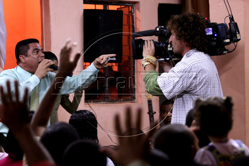 Dancing with the Devil production stills. D.O.P Lance Gewer filming during Pastor Dione's church service.(Australfoto/Douglas Engle)