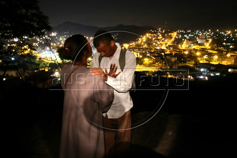 Dancing with the Devil production stills. Ana Lucia and boyfriend pray on hilltop.(Australfoto/Douglas Engle)