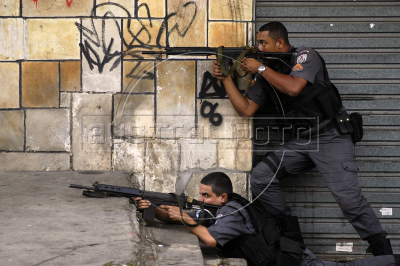 """Police make an incursion into the Vila Cruzeiro slum  in Rio de Janeiro. Life as one of Rio de Janeiro's 38,000 military police officers has never been an easy task, particularly for those whose mission it is to combat the city's three heavily armed drug factions, the Red Command, the Third Command and the Friends of the Friends or """"ADA"""". But a wave of police killings this year has underlined the growing dangers of law enforcement in this seaside tourist capital.(Australfoto/Douglas Engle)"""