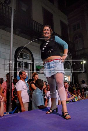 A prostitute parades during a fashion show to launch the Daspu Fall/Winter 2007-2008 clothing collection in Rio de Janeiro,Brazil, January 19, 2007. Daspu is a fashion house founded and run by prostitutes whose designs have become the talk of Brazil's fashion industry nine months after its start. Daspu was founded by Gabriela Leite, ex-prostitute working with Davida, a Brazilian non-gouvernamental organisation that defends the rights of prostitutes. The name Daspu is a play on Daslu, one of Brazil's most expensive and exclusive fashion names being displayed across town by Brazilian elite. Prostitutes and models participate at fashion parade.FOTO:AUSTRAL FOTO/RENZO GOSTOLI)
