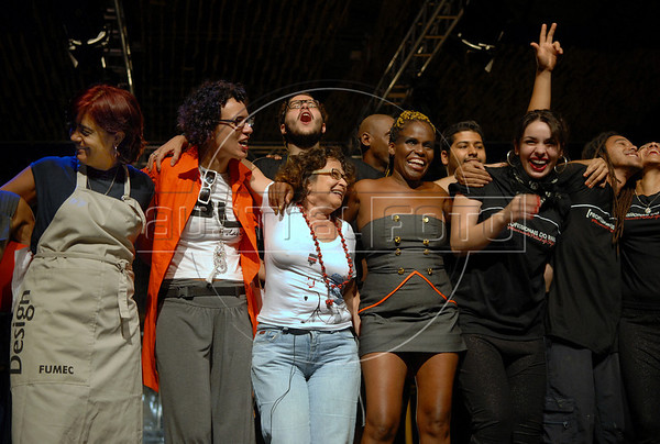 Gabriela Leite, director, center, prostitutes and technicians celebrate at the end of fashion parade of the Daspu Spring/<br /> Summer 2008-2009 collection during the Off Fashion Rio Show, Rio de Janeiro, Brazil June 12, 2008.Daspu was founded and run by prostitutes organizated by the non-profit organization Davida, which its founders claim works towards legalizing prostitution, helps prostitutes defend themselves against prejudice and educates them on sexually-transmitted diseases, presented the first three creations of their fashion label 'Daspu', designed for the prostitutes. (Austral Foto/Renzo Gostoli)