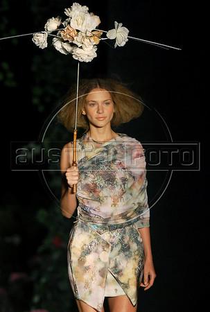 A model shows a design of Filhas de Gaia's 2010-2011 spring/summer collection during the Fashion Rio Show, Rio de Janeiro, Brazil, May 30, 2010.  (Austral Foto/Renzo Gostoli)