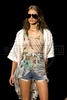 A model wears a creation by Coca Cola Clothing during the Fashion Rio Spring-Summer 2012 collection, Rio de Janeiro, Brazil, June 2, 2011. (Austral Foto/Renzo Gostoli)