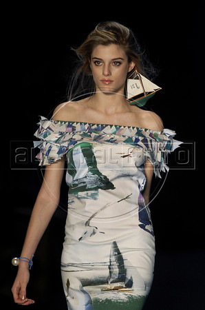 A model wears a creation by Nica Kessler during the Fashion Rio Spring-Summer 2012 collection, Rio de Janeiro, Brazil, June 4, 2011. (Austral Foto/Renzo Gostoli)