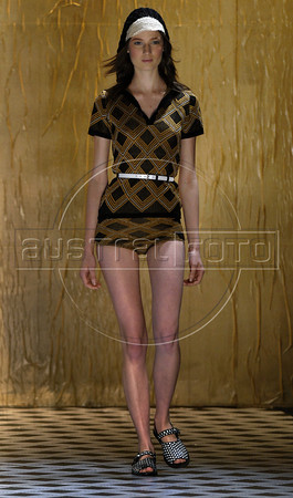 A model shows designs of Totem's 2011 autumn/winter collection during the Fashion Rio Show, Rio de Janeiro, Brazil, January 13, 2011.  (Austral Foto/Renzo Gostoli)