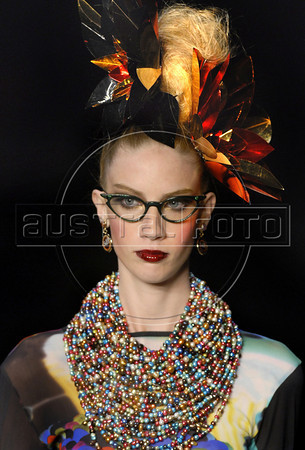 A model shows designs of Alessa's 2011 autumn/winter collection during the Fashion Rio Show, Rio de Janeiro, Brazil, January 11, 2011.  (Austral Foto/Renzo Gostoli)