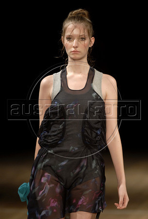 A model shows designs of Acquastudio's 2011 autumn/winter collection during the Fashion Rio Show, Rio de Janeiro, Brazil, January 12, 2011.  (Austral Foto/Renzo Gostoli)