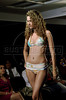 A model wears a creation of Amendoeiras during the fashion parade of 2012 Spring-Summer collection, Rio de Janeiro, Brazil, July 28, 2011. (Austral Foto/Renzo Gostoli)