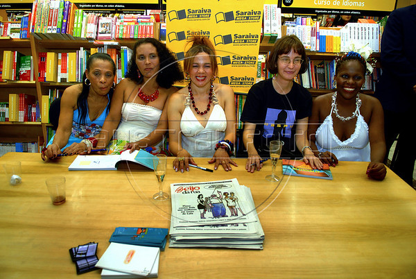 "Prostitutes Maria dos Santos, left, Maria Aparecida, Val, center, and Jane Lucia Eloy, extreme right, participate with the writer Anna Marina Barbara, at presentation of the book ""The Daspu's girls"" speaking about the creation of their fashion label 'Daspu', sponsored by the non-profit organization Davida, Rio de Janeiro, Brazil, June 6, 2007. Davida, which its founders claim works towards legalizing prostitution, helps prostitutes defend themselves against prejudice and educates them on sexually-transmitted diseases, presented the first three creations of their fashion label 'Daspu', designed for the prostitutes. . (Austral Foto/Renzo Gostoli)"
