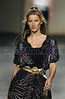 Brazilian top model Gisele Bundchen wears a creation from Colcci 2006 spring/summer collection during the Fashion Rio show in Rio de Janeiro, Brazil, June 17, 2005. (FOTO:AUSTRAL FOTO/RENZO GOSTOLI)