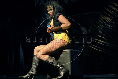 A prostitute performs during the Daspu prostitutes fashion show at Hot Fair, a sex fair, Rio de Janeiro, Brazil, October 30, 2010. Sex workers organisation Daspu, a wordplay on the expression 'Das Putas', that means 'the hookers' in Portuguese, participates at a sex fair with their own sensual designs and performances. (Austral Foto/Renzo Gostoli)