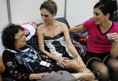 Gabriela Leite, left, leader of non-governamental organisation Davida talks with performers during the Daspu prostitutes fashion show at Hot Fair, a sex fair, Rio de Janeiro, Brazil, October 30, 2010. Sex workers organisation Daspu, a wordplay on the expression 'Das Putas', that means 'the hookers' in Portuguese, participates at a sex fair with their own sensual designs and performances. (Austral Foto/Renzo Gostoli)