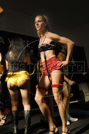 A participant performs during the Daspu prostitutes fashion show at Hot Fair, a sex fair, Rio de Janeiro, Brazil, October 30, 2010. Sex workers organisation Daspu, a wordplay on the expression 'Das Putas', that means 'the hookers' in Portuguese, participates at a sex fair with their own sensual designs and performances. (Austral Foto/Renzo Gostoli)