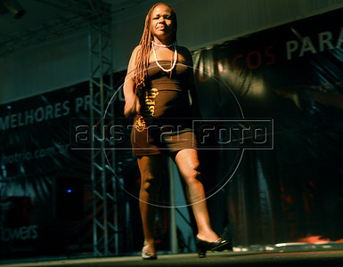 A prostitute perform durings the Daspu prostitutes fashion show at Hot Fair, a sex fair, Rio de Janeiro, Brazil, October 30, 2010. Sex workers organisation Daspu, a wordplay on the expression 'Das Putas', that means 'the hookers' in Portuguese, participates at a sex fair with their own sensual designs and performances. (Austral Foto/Renzo Gostoli)