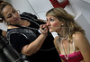 A participant prepares to perform during the Daspu prostitutes fashion show at Hot Fair, a sex fair, Rio de Janeiro, Brazil, October 30, 2010. Sex workers organisation Daspu, a wordplay on the expression 'Das Putas', that means 'the hookers' in Portuguese, participates at a sex fair with their own sensual designs and performances. (Austral Foto/Renzo Gostoli)