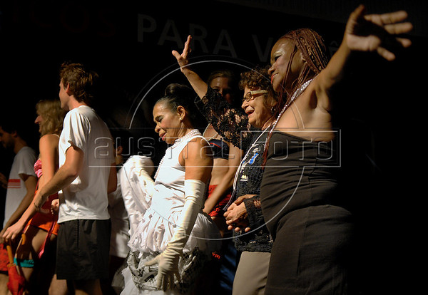 Gabriela Leite, center, leader of non-governmental organisation Davida, and prostitutes celebrate at the end of the Daspu prostitutes fashion show at Hot Fair, a sex fair, Rio de Janeiro, Brazil, October 30, 2010. Sex workers organisation Daspu, a wordplay on the expression 'Das Putas', that means 'the hookers' in Portuguese, participates at a sex fair with their own sensual designs and performances. (Austral Foto/Renzo Gostoli)