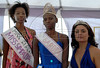 Joyce da Silva, 25, center, poses with Rusky Mthethna from Southafrica, left, 3td placed, and Jessica Borges, right, 2nd. placed, after she was elected the most beautiful (Garota Talavera Bruce) among 15 contestants of three prisons in a beauty pageant held at the Talavera Bruce prison in Rio de Janeiro, Brazil,  November 25, 2008. The Miss Talavera Bruce Beauty Pageant is an important break from the routine life of about 330 female inmates in the maximum security prison. The Rio de Janeiro prison is a notorious Bangu area, where some of Rio's top drug traffickers are held. The fifth annual pageant, which the VivaRio non-governmental organization helps organize, tries to transform these dangerous criminals into beautiful, dazzling, beauty pageant hopefuls for one day. (Austral Foto/Renzo Gostoli)