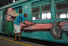 Brazilian popular artist Anderson Duin, 30, paints a train at Engenho de Dentro station, Rio de Janeiro, Brazil, Nov. 3, 2007.<br /> More than 20 street artists participated in the event, sponsored the Supervia commuter railroad and by non-governmental organizations that work with social assistance for youths from slums and poor communities.  (AUSTRAL FOTO/RENZO GOSTOLI)