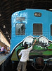 Brazilian popular artist Nitzho, 26, paints a train at Engenho de Dentro station, Rio de Janeiro, Brazil, Nov. 3, 2007.<br /> More than 20 street artists participated in the event, sponsored the Supervia commuter railroad and by non-governmental organizations that work with social assistance for youths from slums and poor communities.  (AUSTRAL FOTO/RENZO GOSTOLI)