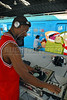 Brazilian DJ Roger Flet, 36, plays hip-hop music while popular artists paint a train at Engenho de Dentro station, Rio de Janeiro, Brazil, Nov. 3, 2007.<br /> More than 20 street artists participated in the event, sponsored the Supervia commuter railroad and by non-governmental organizations that work with social assistance for youths from slums and poor communities.  (AUSTRAL FOTO/RENZO GOSTOLI)