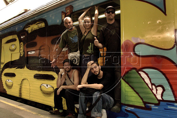 The five artists pose in a train painted by there at Central do Brasil (Brazil's Central station), Rio de Janeiro, Brazil,  Feb. 7, 2006. Popular artists Otavio and Augusto Pandolfo, knows as Os Gemeos (The Twins), Nina, Ise and Coio have paints a train with four wagons of 90 meters, inaugurated today. The work is patricinated by Supervia , a brazilian railways company in a program to paints buildings and other trains by artists.  (FOTO:AUSTRAL FOTO/RENZO GOSTOLI)