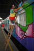 A Brazilian popular artist paints a train at Engenho de Dentro station, Rio de Janeiro, Brazil, Nov. 3, 2007.<br /> More than 20 street artists participated in the event, sponsored the Supervia commuter railroad and by non-governmental organizations that work with social assistance for youths from slums and poor communities.  (AUSTRAL FOTO/RENZO GOSTOLI)