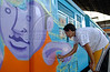 Brazilian popular artist Carlos Bobi, 24, paints a train at Engenho de Dentro station, Rio de Janeiro, Brazil, Nov. 3, 2007.<br /> More than 20 street artists participated in the event, sponsored the Supervia commuter railroad and by non-governmental organizations that work with social assistance for youths from slums and poor communities.  (AUSTRAL FOTO/RENZO GOSTOLI)