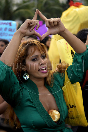 "A woman participates at the ""Marcha das vadias"", inspirated by the Slut Walk, a march against sexism and in favor of women's rights wich started in Canada and has been spreading all around the world, at the Copacabana beach, Rio de Janeiro, Brazil, July 2, 2011. Women at the ""Marcha das vadias"" in Rio complain about the high rates of violence against women in Brazil. (Austral Foto/Renzo Gostoli)"